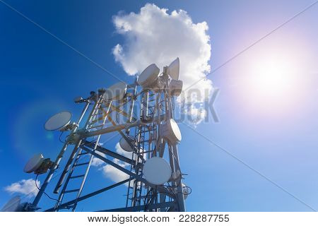 Telecommunication Tower With Tv Antennas, Satellite Dish, Microwave And Panel Antennas Of Mobile Ope
