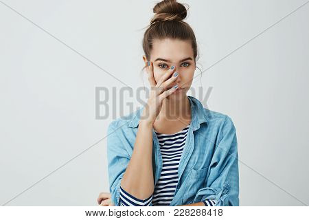 What The Hell Are You Wearing. Portrait Of Girl Who Feels Embarrassed, Covering Face With Palm, Look