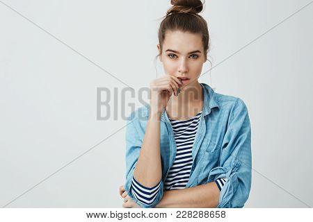 Girl Wants To Believe Boyfriend But Knows He Is Lying. Studio Shot Of Suspicious Focused Woman With