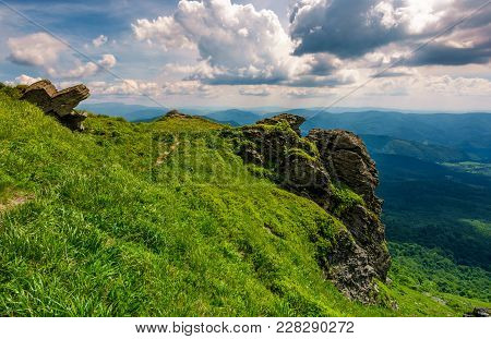 Grassy Hillside Over The Cliff In Mountains. Beautiful Mountain Ridge In The Distance. Viewing Locat