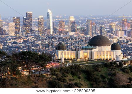 Griffith Observatory Park With Los Angeles Skyline At Dusk. Twilight Views Of The Famous Monument An