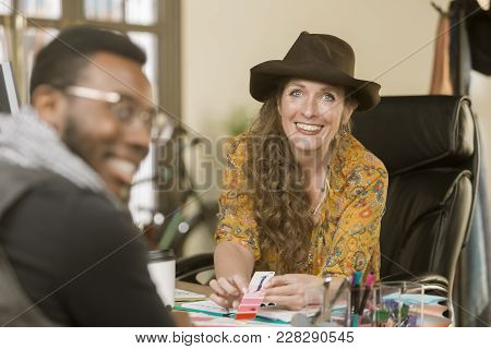 Stylish Woman In Her Office With Colleague Or Client
