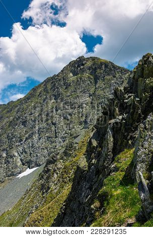 Rocky Cliffs Of Fagaras Mountains In Summertime. Beautiful Nature Scenery On High Altitude
