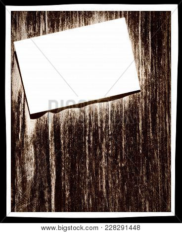 White Paper Blank On Grunge Wooden Wall With Frame Border And Empty Space For Text.digitally Altered