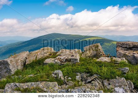 Hillside Of Runa Mountain In Summer. Beautiful Landscape With Huge Boulders In Grass