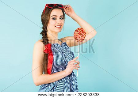 Close Up Portrait Of Brunette Young Pin-up Woman In Striped Shirt With Sunglasses Isolated On Blue B