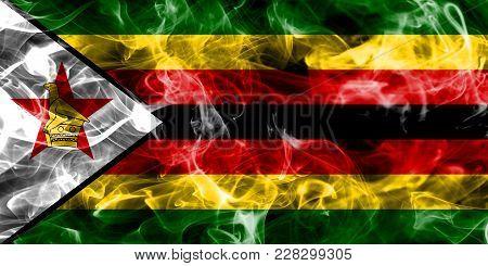 Zimbabwe Smoke Flag Isolated On A Black Post