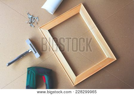 Tools For Stretching A Canvas On Stretcher Bars. Canvas Print, Wooden Stretcher, Staple Gun And Plen