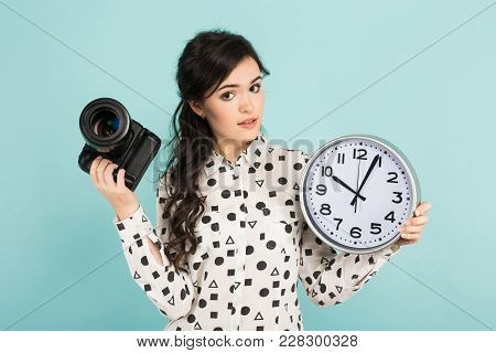 Portrait Of Young Attractive Woman Photographer In White Shirt Holding Camera And Watches Isolated O