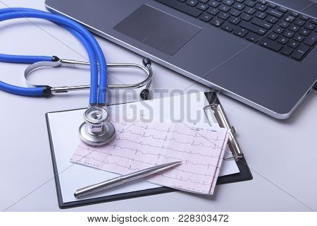 Workplace Of Doctor With Laptop, Stethoscope, Rx Prescription And Notebook On White Table. Top View.