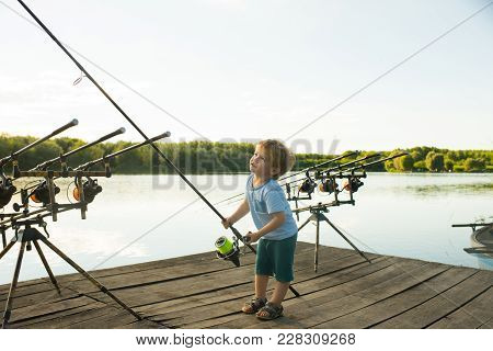 Angling Child With Fishing Rod On Wooden Pier. Angling, Fishing, Activity, Adventure, Hobby, Sport.