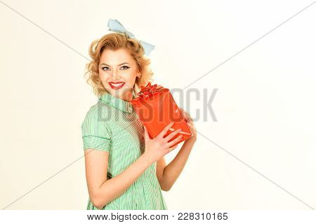 Portrait Of Beautiful Young Happy Smiling Woman In Pin-up Style Clothing, Holding Gift Box, Isolated