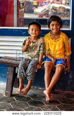 Siem Reap, Cambodia- March 22, 2013: Two Unidentified Smiling Khmer Children In Cambodia. Khmer Peop