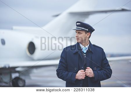 Side View Serene Young Aviator Moving Outdoor Opposite Plane. Occupation Concept