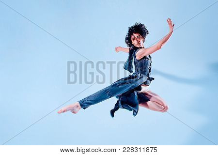 Modern Teen Contemporary Dancer Poses In Front Of The Studio Background. Toned Image.