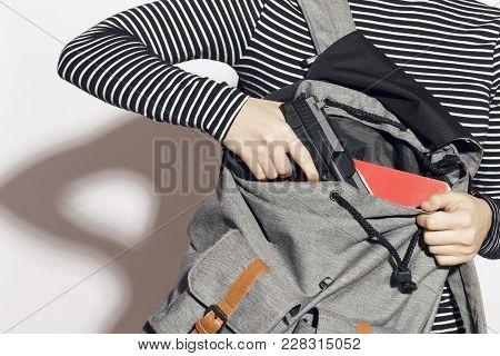 Girl Hiding A Gun In Her School Backpack.