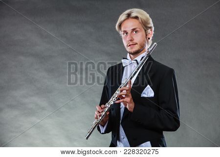 Classical Music, Passion And Hobby Concept. Portrait Of Elegantly Dressed Musician Blonde Young Man