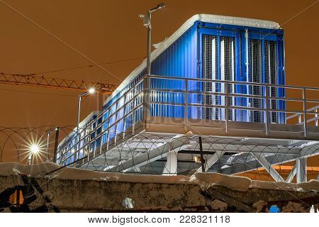 Blue Trailer Locker Room For The Workers At The Construction Site On The Background Of A Crane At Ni