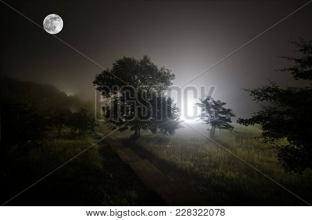 Beautiful Night Landscape Of Big Full Moon Rising Over The Mountain Road With Hill And Trees, Mystic