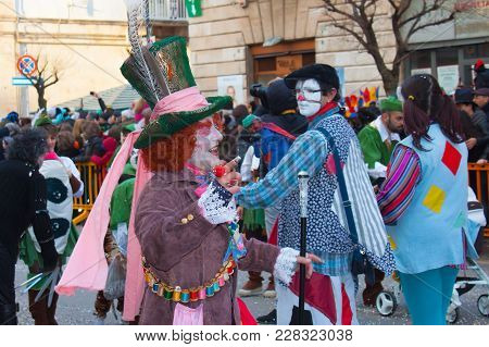 Putignano, Italy. February 11, 2018: The Annual Traditional Costumed Carnival. Smiling Man In A Hatt