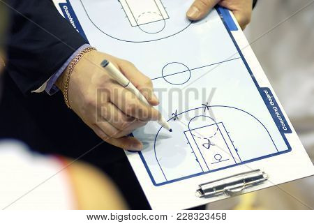 Basketball Coach Write Tactics On Plastic Coaching Board