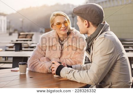 Amorous Glance. Portrait Of Attractive Girl In Sunglasses Is Sitting At Table With Her Boyfriend. Sh