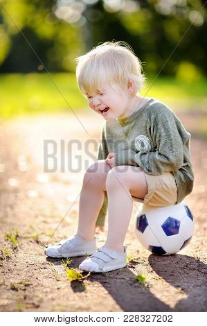 Little Boy Crying After Fall During Soccer/football Game On Summer Day. Active Outdoors Game/sport F