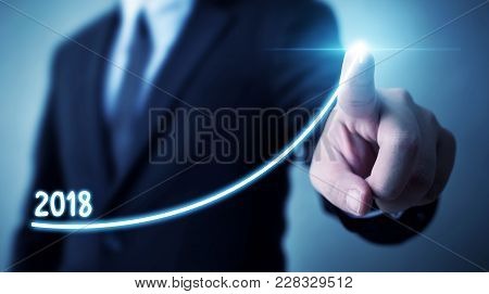 Business Development To Success And Growing Annual Revenue Growth 2018 Concept, Businessman Pointing