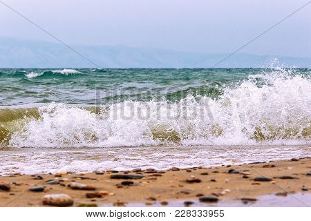 Landscape With The Image Bad Weather, Storm And Waves On The Lake Baikal