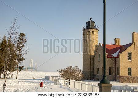 Old Mackinac Point Lighthouse And Mackinac Bridge On Frozen Straits Of Mackinac,  Mackinac City, Mic