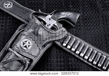 Old Cowboy 45 Pistol And Leather Tooled Holster In Black And White..