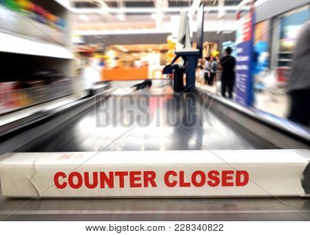 Cashier Counter Closed Sign With Blur Background