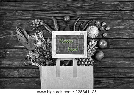 Black And White Photo, Full Paper Bag With Green Vegetables And Green Fruits. Vegetarian Food. Healt