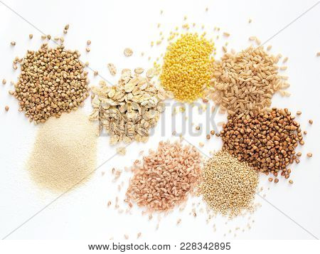 Set Of Heap Various Grains And Cereals - Raw Green Buckwheat, Semolina, Oat Flakes, Millet, Brown Ri