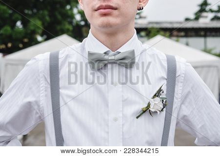 Close-up A Man In White Shirt With Bow Tie And Suspender