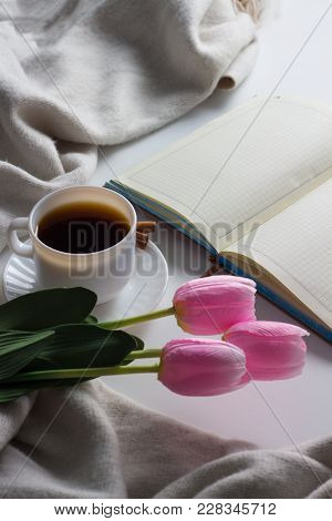 Notebook, Cup Of Hot Coffee, Scarf, Tulips On White Background. Spring Concept. Flat Lay, Top View