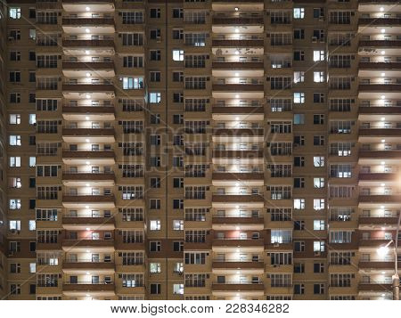 Night View Of Exterior Apartment Building. High Rise Apartments In Night Light