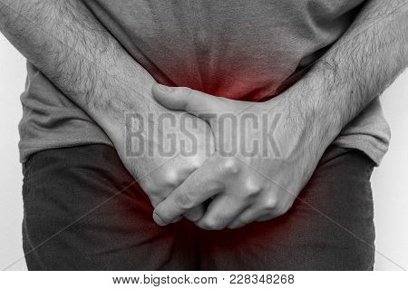 Man With Incontinence Problem Is Holding His Crotch - Black And White Photo