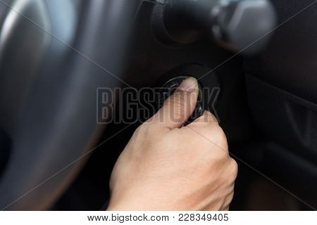 Close Up Of Hand Turning The Car Engine On