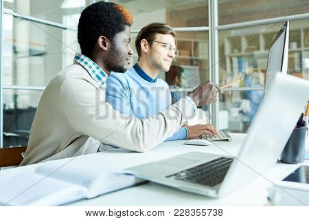 Multi-ethnic Group Of Financial Managers Gathered Together In Front Of Computer And Preparing Annual