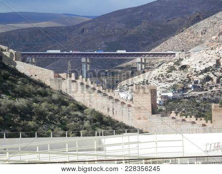 Lorries On Motorway Viaduct Bridge Crossing Valley North Of Almeria, Spain