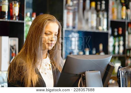 A Woman Registrating New Order By Cash-register