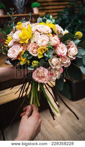 Crop Person In Flower Market Presenting Beautiful Tender Bouquet With Colorful Flowers.