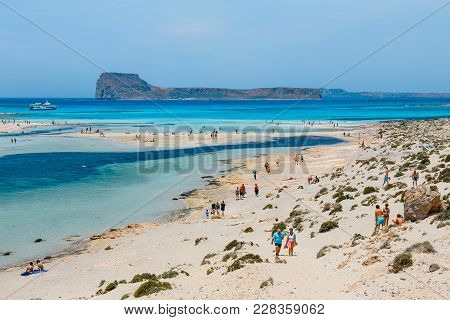 Crete, Greece, May 24, 2016: People Relaxing At Balos Beach In Crete, Greece. Balos Beach Is One Of