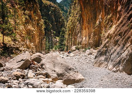 Crete, Greece, May 26, 2016: Tourists Hike In Samaria Gorge In Central Crete, Greece. The National P