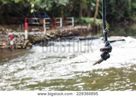 The Rope For Jump Into Water. It Is Happy To Jump.