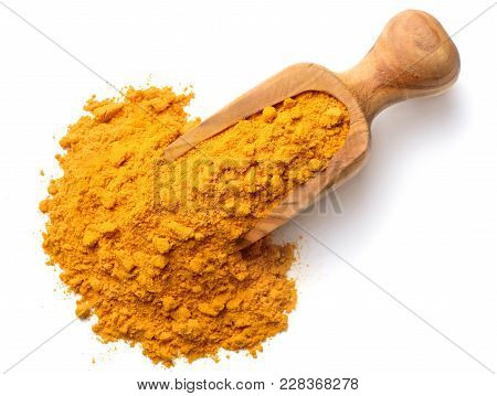Turmeric Powder In The Wooden Scoop, Isolated On White Background