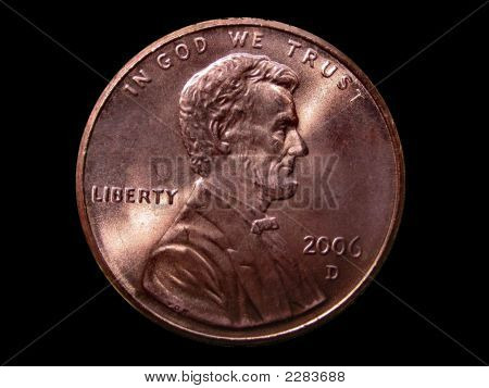 Front Side Of A Penny Over Black