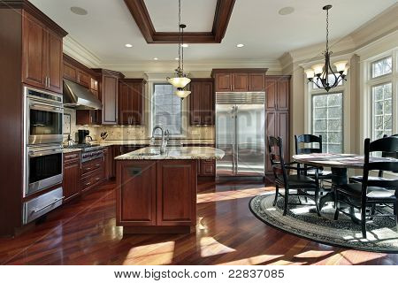 Luxury kitchen with cherry wood cabinetry and eating area