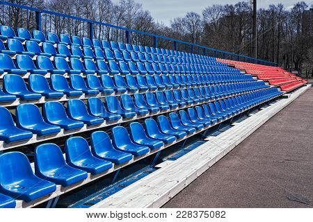 The Plastic Seats Are Waiting For Audience At A Sports Stadium In Tallinn, The Capitol Of Estonia. H